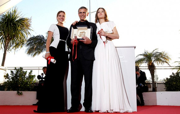 From left to right: actress Lea Seydoux, director Abdellatif Kechiche, and actress Adele Exachopoulos. Kechiche is holding the Palme d'Or
