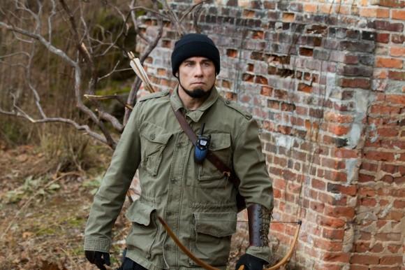 John Travolta as Bosnian War vet Emil Kovac in the upcoming 'Killing Season,' which he stars in opposite Robert DeNiro. 'Killing Season' hits theaters July 12.
