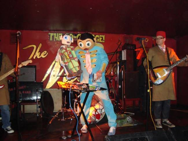UK culst legend Frank Sidebottom performing with 'Little Frank'