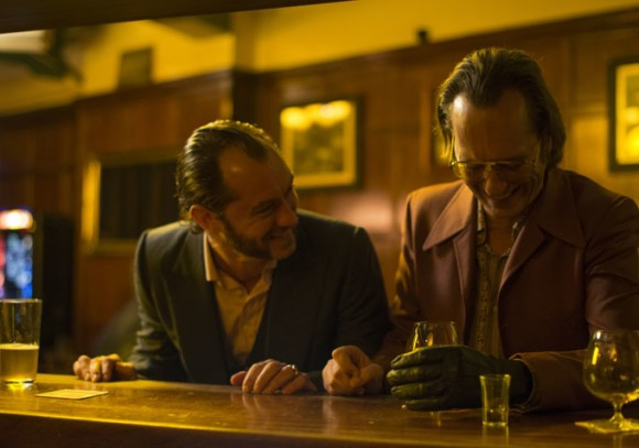 """Jude Law as the titular character """"Dom Hemingway"""" alongside his partner-in-crime played by Richard E. Grant."""