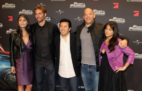 Justin Lin (center) with the cast of 'Fast & Furious'