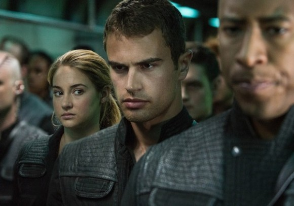Theo James as Four with Shailene Woodley as Tris looking over his shoulder