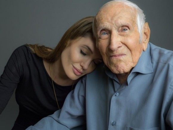 Director Angelina Jolie and the real Louis Zamperini, who passed away earlier this year