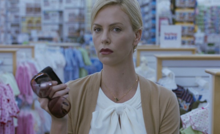 Charlize Theron Attached to Star and Produce 'Need to Know'